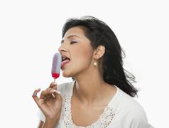 Woman licking an ice cream - stock photo