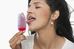 Woman licking an ice cream Stock Photos