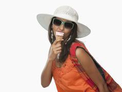 Woman eating an ice cream cone - stock photo