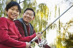 Stock Photo of Grandfather and grandson fishing portrait