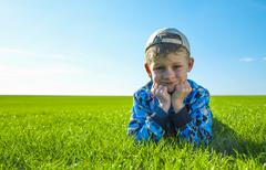 Little boy on meadow - stock photo