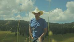 Walking up hill walk COWBOY HAT Stock Footage