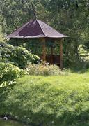 beautiful wooden summerhouse and flowers - stock photo