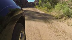 Driving POV car wheel desert canyon dirt road HD 0059 Stock Footage