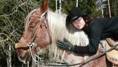 Girl cowboy sitting on a horse Stock Footage