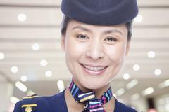 Portrait of air stewardess - stock photo