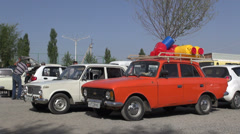 Old Soviet cars in Uzbek parking lot Stock Footage
