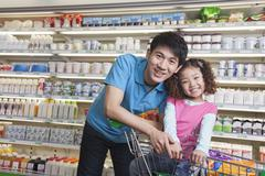 Father and Daughter Shopping in Supermarket, Looking at camera Stock Photos
