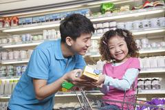 Stock Photo of Father and Daughter Shopping in Supermarket