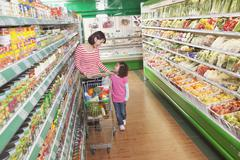 Mother and Daughter in Supermarket Shopping Stock Photos