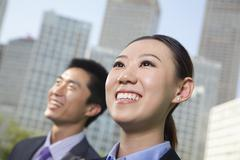 Portrait of two young business people outside in the business district, Beijing - stock photo