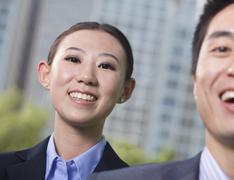 Stock Photo of Portrait of two young business people outside in the business district, Beijing