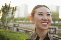 Stock Photo of Portrait of young woman outside, Beijing