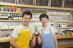 Stock Photo of Portrait of two baristas at a coffee shop, Beijing