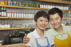 Portrait of two baristas at a coffee shop, Beijing - stock photo