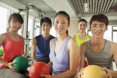 Stock Photo of Group of young people in the gym, portrait