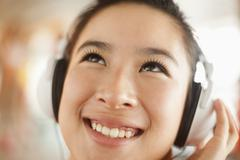 Young women listening to music, portrait Stock Photos