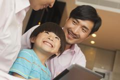 Son and his parents using digital tablet Stock Photos
