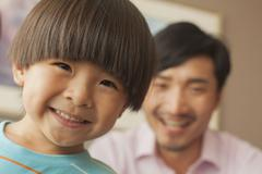 son with father smiling, portrait - stock photo