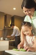 Family preparing dinner - stock photo