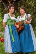 Stock Photo of Two female German singers in dirndls