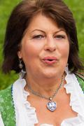 Portrait of a Bavarian woman in dirndl with good mood Stock Photos