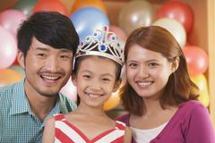 Portrait of Family on Daughter's Birthday - stock photo