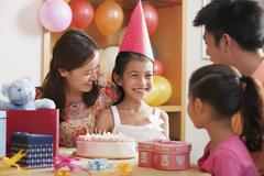 Family Celebrating Girl's Birthday Stock Photos