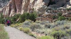 Friends walking historic Swasey Cabin San Rafael desert Utah 2 HD 9899 Stock Footage
