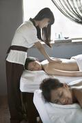 Mother and Daughter Having Back Massage Together - stock photo