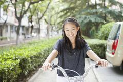 Young Girl Riding Her Bicycle - stock photo