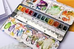 picture of messy, used aquarelle paintbox - stock photo