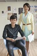 Portrait of Two Business People in Creative Office Stock Photos