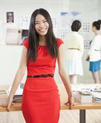 Stock Photo of Smiling Businesswoman in Creative Office