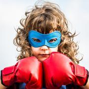 Superhero kid. girl power concept Stock Photos