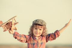 happy kid playing with toy airplane - stock photo