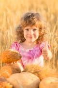happy child holding bread - stock photo