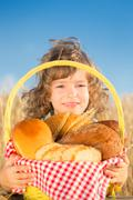 happy child with bread in basket - stock photo