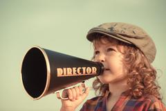 kid shouting through megaphone - stock photo
