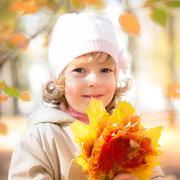 child in autumn park - stock photo