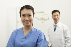 Portrait Of Smiling Female Dental Assistant In Clinic - stock photo