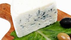 Stilton cheese on wood Stock Footage
