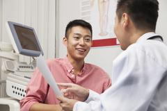 Young Man Talking With Doctor Stock Photos