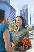 Mature Business Woman With Flowers Stock Photos