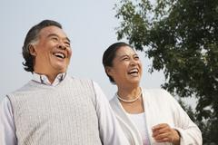 Happy senior couple walking outdoors in Beijing - stock photo