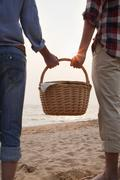 Young Couple Holding Picnic Basket Stock Photos