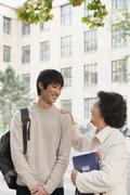 Student talking with his professor - stock photo