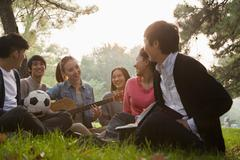 Teenagers hanging out in the park - stock photo