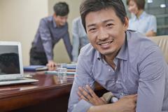 Portrait of Smiling Businessman Stock Photos