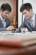 Businessmen Using Mobile Phone - stock photo
